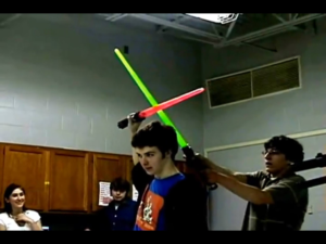 Kid blocking lightsaber from behind Subterfuge meme template