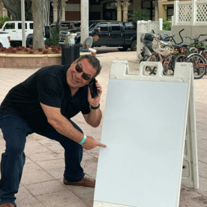 Phill Swift pointing to sign (blank) Holding Sign meme template