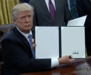 Trump Holding New Law (blank) Holding Sign meme template