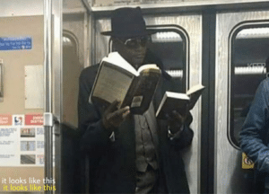 Black Guy Reading Two Books Smart meme template