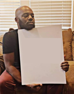 Disappointed Black Man Holding Sign Holding Sign meme template