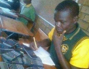 Black kid looking at calculators Black Twitter meme template