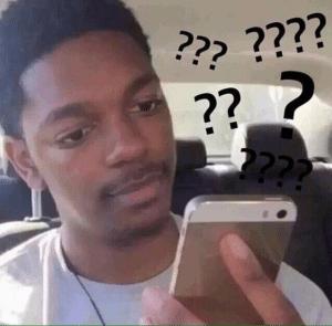 Black guy looking at phone confused Black Twitter meme template