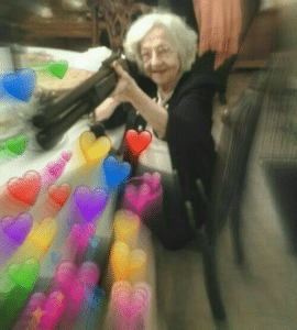 Old woman shooting hearts from shotgun Gun meme template