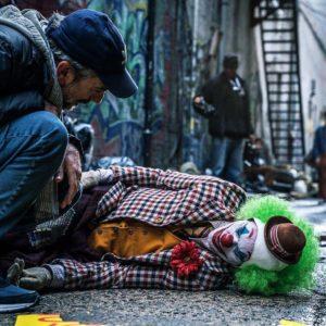Man looking down at Joker on the ground  Clown meme template