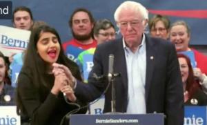 Girl taking mic from Bernie Taking meme template