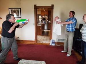 Priest baptizing baby with water gun Gun meme template