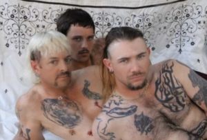 Joe Exotic and his husbands in bed NSFW meme template