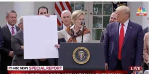 Holding Sign next to Trump Holding Sign meme template