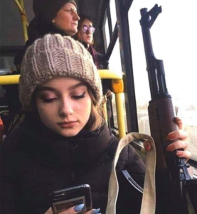 Girl with AK-47 looking at phone Opinion meme template