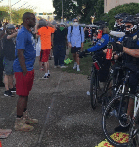 Cop pepper spraying black man Black Twitter meme template