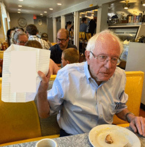 Bernie Sanders holding paper Holding Sign meme template